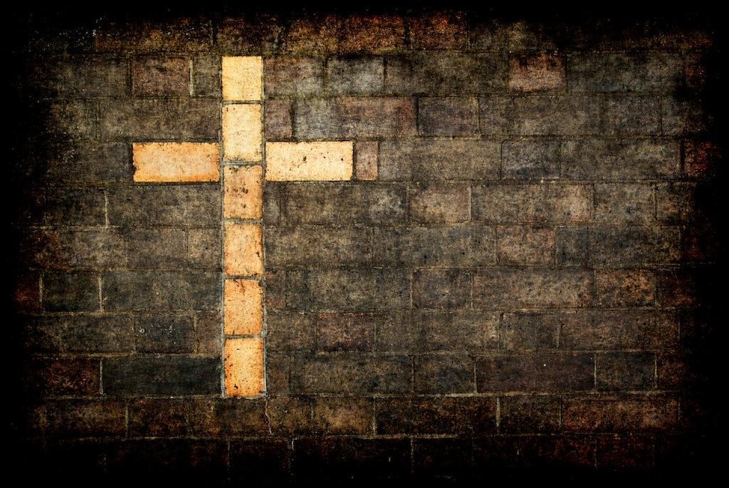cross of christ built into a brick wall